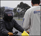 Motorcyclist learning to ride a motorcycle